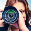 Young girl with photocamera — Foto de Stock
