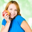 Portrait of young beauty woman with red apple — Lizenzfreies Foto
