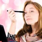 Pretty woman applying make up. — Stock Photo #21574065