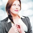 Stock Photo: Portrait of an attractive business woman dreaming