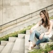 Portrait of a beautiful european woman sitting om steps — Stock Photo