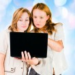 Two young businesswomen working on laptop. — Stock Photo #21574537