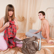 Young couple in quarrel. The girl collects things — Stockfoto