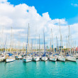 Beautiful white yachts at sea port with blue cloudy sky in backg - Stock Photo