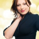 Beautiful young adult girl in black elegant dress — Stock Photo #21575161