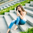 Stock Photo: Portrait of beautiful europewomsitting om steps