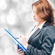 Stock Photo: Isolated business woman holding a portfolio