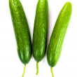 Stock Photo: Healthy food. The green cucumbers isolated on white background
