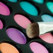 Multicolored eye shadows with cosmetics brush — Stock Photo #21576045