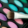 Multicolored eye shadows with cosmetics brush — Stock Photo #21576809
