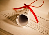 Diploma with red ribbon — Stockfoto