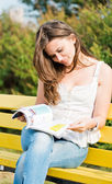 Woman read a magazine in park — Stock Photo