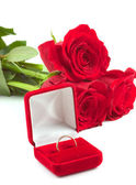 Roses and wedding ring — Stock Photo