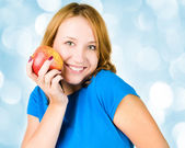 Portrait of young beauty woman with red apple — Stock Photo