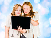 Two young businesswomen working on laptop. — Stock Photo