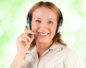 Business customer support operator woman smiling - isolated — Stockfoto