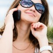 Outdoor portrait of young woman with phone — Stock Photo #22560259