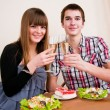 Foto Stock: Young, attractive, happy, smiling couple celebrating with champa