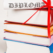 Diploma with red ribbon and books - Foto de Stock