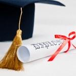 Graduation hat and Diploma — Stock Photo #22564703