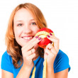 Portrait of a young sport woman holding apple and measuring tape — Stockfoto
