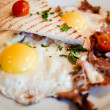 Fried eggs with bacon and toasts — Stock Photo #22565563