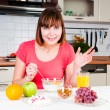 Beautiful woman having a healthy breakfast — Stock Photo
