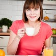 Stock Photo: Young woman enjoying a cup of coffee