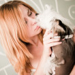 Woman with a cute little dog — Stock Photo