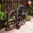 Old wood coach wheel around barn. Bulgaria - Stock Photo