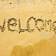 Welcome written in a sandy tropical beach — Photo