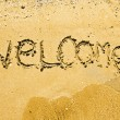 Welcome written in a sandy tropical beach — 图库照片