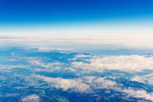 Flying over the mountains with clouds — Stock Photo