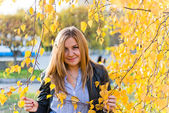 Close up portrait of autumn woman with yellow leaves — Stock Photo