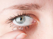 Close up of inserting a contact lens in female eye — Stock Photo