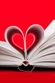 Pages of a book curved into a heart shape — 图库照片