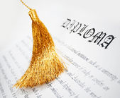Diploma with tassel from Graduation hat — Stock Photo