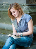 Woman sitting and reading in Prague — Stock Photo
