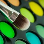 Multicolored eye shadows with cosmetics brush — Stock Photo #22851198
