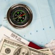 Compass, money and passport with boarding pass — Stock Photo
