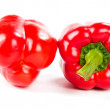 Two fresh red peppers on white — Stock Photo #22851626