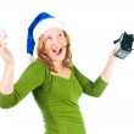Beautiful happy woman looking inside black shopping gift bag loo — Stock Photo #22851706