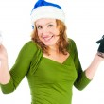 Beautiful happy woman looking inside black shopping gift bag loo — Stock Photo #22851708