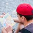 Stock Photo: Tourists on street looking at guide