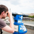 The man looks through telescope in Prague — Stock Photo
