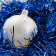 Christmas-tree decorations and blue tinsel  — Стоковая фотография