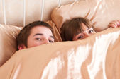 Young couple in a bed — Stock Photo