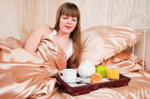Surprised girl in bed. — Stock Photo