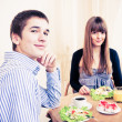 Young caucasian couple dining in restaurant  — Stock Photo