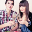 Stockfoto: Young, attractive, happy, smiling couple celebrating with champa